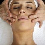 Hands giving facial massage